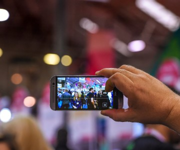 6 November 2014; An attendee captures the scene with a smartphone during Day 3 of the 2014 Web Summit in the RDS, Dublin, Ireland. Picture credit: Ray McManus / SPORTSFILE / Web Summit